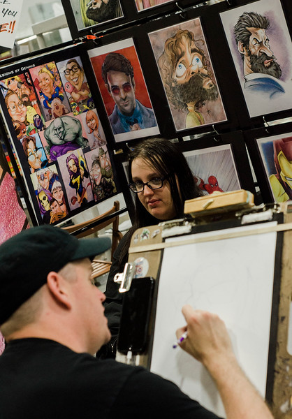 Amanda Brehil, of Fitchburg, poses for a caricature by Dennis Burke during the Plastic City Comic Con held at the Wallace Civic Center in Fitchburg on Saturday, July 29, 2017. SENTINEL & ENTERPRISE / Ashley Green