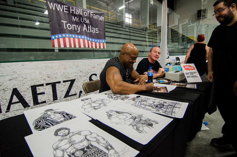 WWE Wrestler Tony Atlas signs photos during the Plastic City Comic Con held at the Wallace Civic Center in Fitchburg on Saturday, July 29, 2017. SENTINEL & ENTERPRISE / Ashley Green