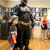 Ellis Capshaw, 4, from Gardner poses for a picture with Batman, aka Matches Malone of Boston, at the Plasic Comic Con in Leominster on Saturday. SENTINEL & ENTERPRISE/JOHN LOVE