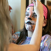 Teaghan Varney, 10, from Baldwinville gets her face painted by makeup artist Julie Le Shane of Waltham at the Plastic City Comic Con in Leominster on Saturday. SENTINEL & ENTERPRISE/JOHN LOVE