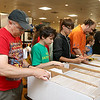Bob Hudson of Medway, in red shirt, and Maxwell DeRienze, in Green, of Leominster look through the many comic books at the Plastic City Comic Con at the Veterans Memorial Center in Leominster on Saturday. SENTINEL & ENTERPRISE/JOHN LOVE