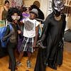 Dressing up for the Plastic City Comic Con on Saturday in Leominster at the Veterans Memorial Center on West Street is from left Tracey Vilgrain, 11, playing Lil G, Ernest Vilgran, 11, playing Kid Anime and their uncle Marcos Vilgran, all from Manchester N.H, playing the Black Panther. SENTINEL & ENTERPRISE/JOHN LOVE
