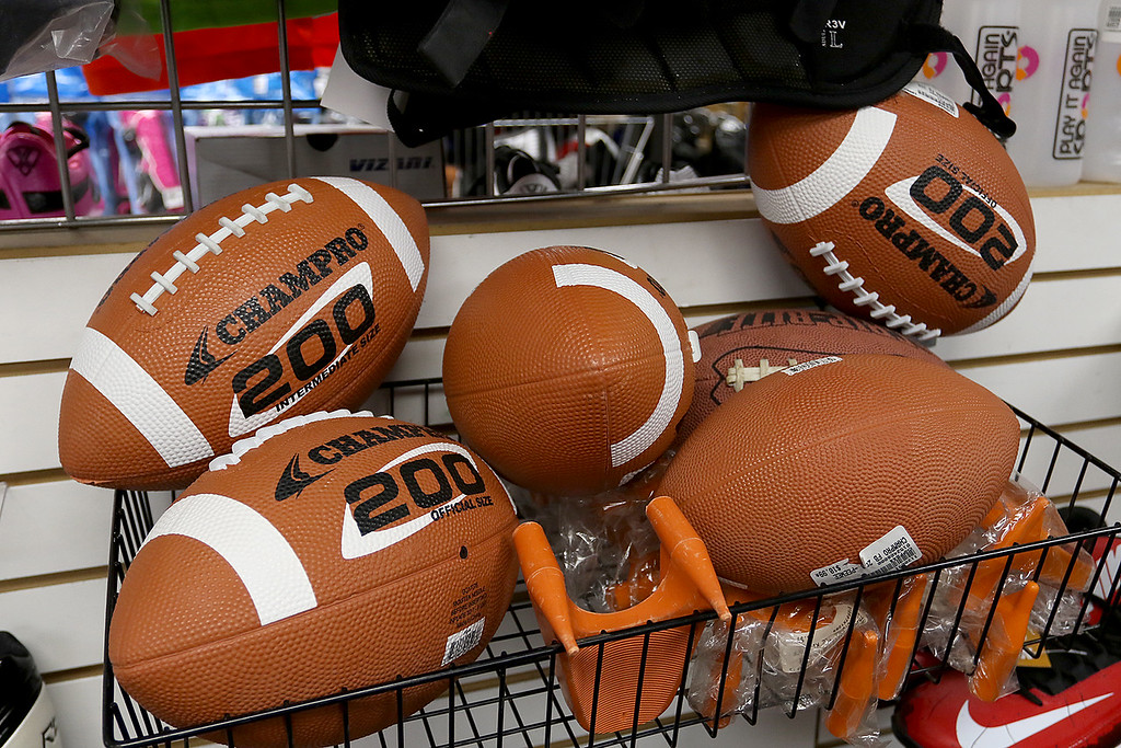 . Play It Again Sports in Leominster has a new Owner/Manager Sandy Pellecchia. Some footballs they sell. SENTINEL & ENTERPRISE/JOHN LOVE
