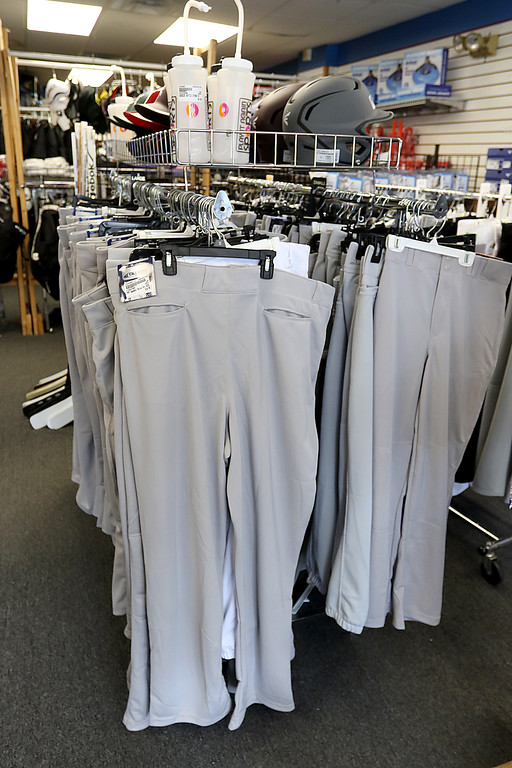 . Play It Again Sports in Leominster has a new Owner/Manager Sandy Pellecchia. They have racks of baseball pants for sale. SENTINEL & ENTERPRISE/JOHN LOVE