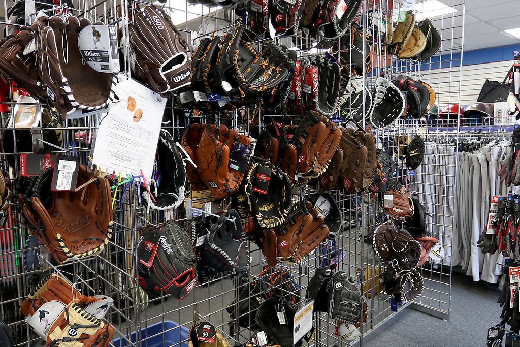. Play It Again Sports in Leominster has a new Owner/Manager Sandy Pellecchia. Some of the baseball gloves they sell. SENTINEL & ENTERPRISE/JOHN LOVE