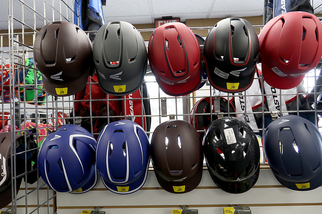. Play It Again Sports in Leominster has a new Owner/Manager Sandy Pellecchia. Some of the helmets they sell. SENTINEL & ENTERPRISE/JOHN LOVE