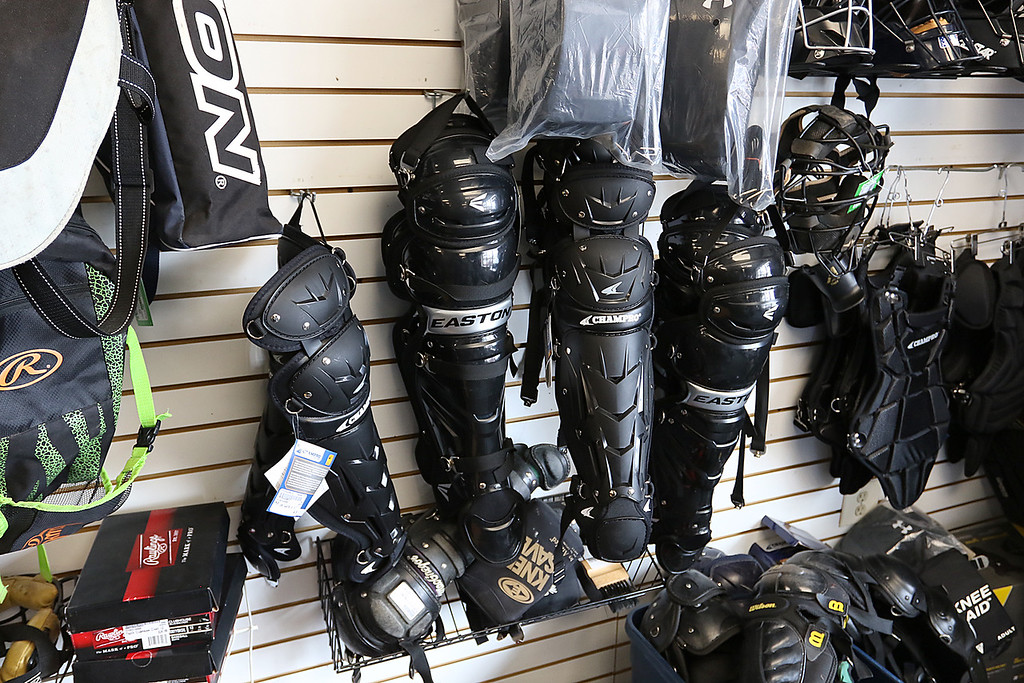 . Play It Again Sports in Leominster has a new Owner/Manager Sandy Pellecchia. Some of the catcher\'s equipment they sell. SENTINEL & ENTERPRISE/JOHN LOVE