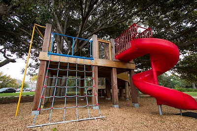 Fort with climbing net and spiral red plastic slide