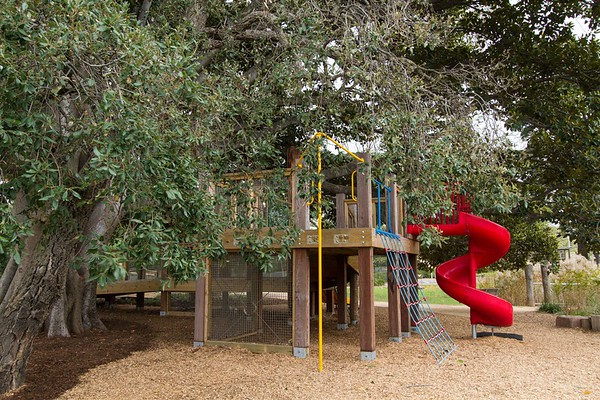 Fort with climbing net, red plastic spiral slide & firepole