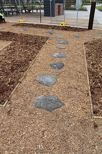 rock stepping stones in mulch path