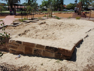 raised sandpit with sandstone edging and accessible trays
