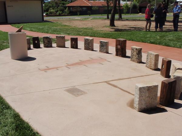 timber and sandstone block sundial sculpture