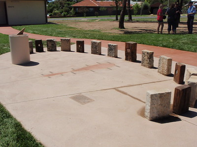 timber and sandstone block sundial sculpture