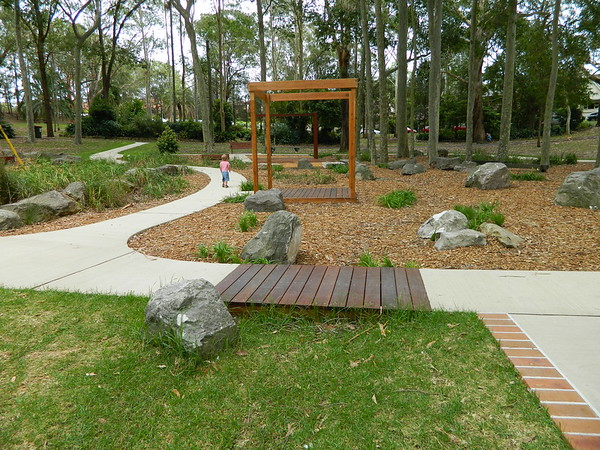 open plan timber cubby and timber bridge
