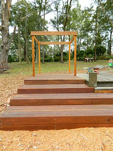 open plan timber cubby and timber decking seating
