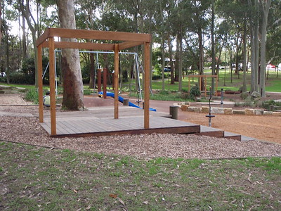 open plan timber cubby on deck with seating steps