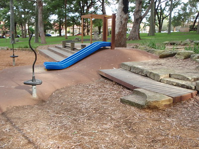 dual blue plastic slide on mound with softfall rubber abd spinner and timber ramp