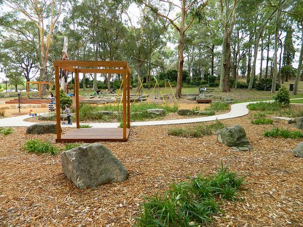 open plan timber cubby and bolder landscaping