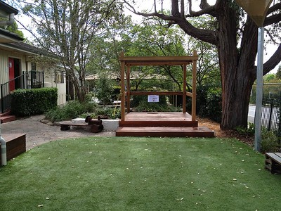 open plan timber cubby with step deck and artificial turf
