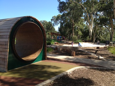 mouse wheel and giant sandpit with stepping stones and log rounds seating in mulch