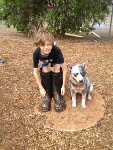 dog and boots sculpture with kid