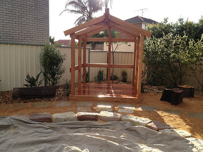 open plan timber house cubby and stepping stone pathway