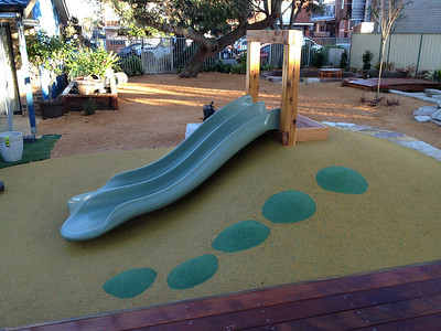 dual green plastic side on mound with rubber softfall and moulded boulder clambering