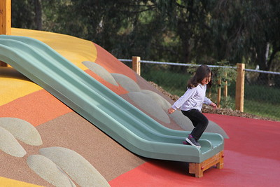 dual green plastic slide on soft fall rubber embankment