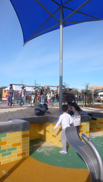 raised sandpit with blue shade structure