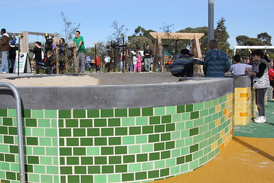 raised sandpit with coloured bricks and concrete cpping
