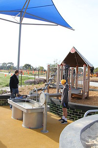 water play with archimedes screw and hand pump and water trough and cubby