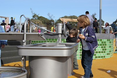 water play with hand pump trough and channel