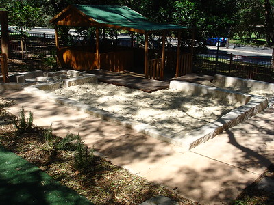 sandpit with sandstone block edging and water play