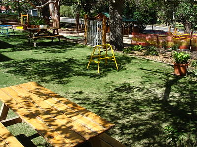 picnic table & bench on artificial turf and musical chimes