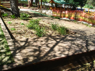 timber ramp boardering garden