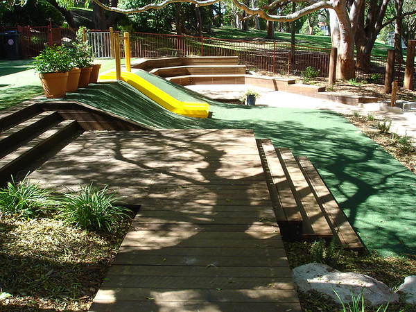 panorama timber deck with sitting steps and slide on mound and timber amphitheatre