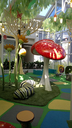 grub mushroom plant and tree sculptures on artificial turf