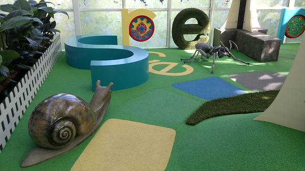 snail and ant sculptures on artificial turf and decorative  letters and sitting