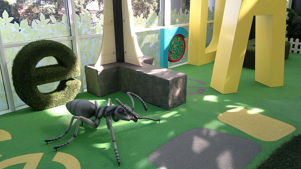 ant sculpture on artificial turf and decorative letters