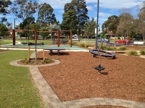 spinner and timber steel seating platform and nova spinner and timber swing with brick garden edging