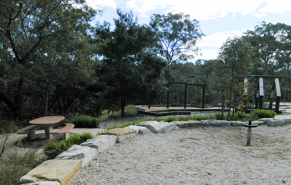 spinner on softfall mulch with sandstone block retaining and bbq table