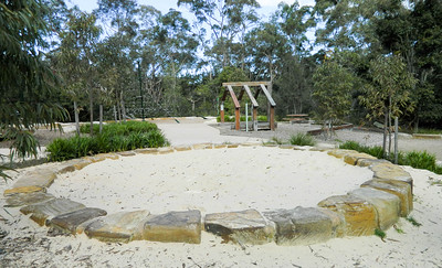 sandpit with sandstone block edging and open plan cubby and pentagoda net