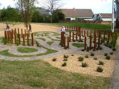 maze with block work paths and timber poles