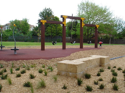 triple timber swing and spinners and sandstone block seating