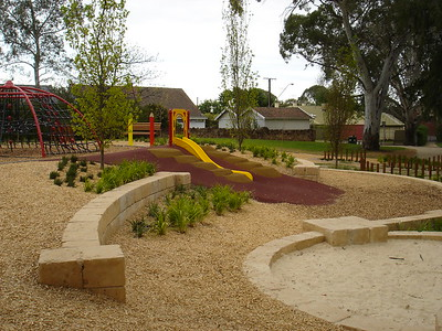 sandstone block retaining and sandpit and slide on mound