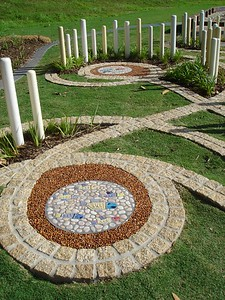 maze with block paths and poles and inlaid moziac artwork circles