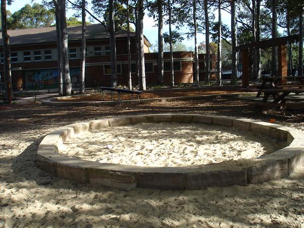 circular sandpit with sandstone edging