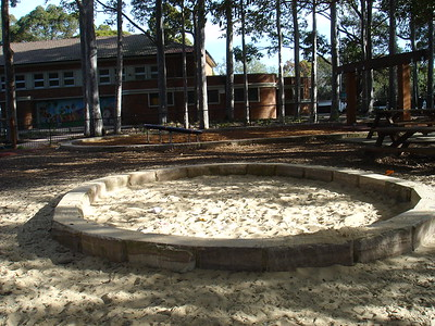 circular sandpit with sandstone edging