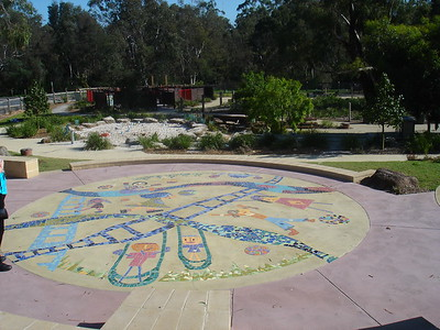 inlaid children's artwork in concrete path