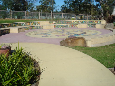 block work amphitheatre with inlaid children's artworks